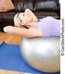 Relaxed woman doing exercice at home