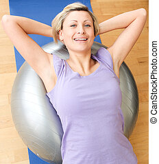 Jolly woman doing exercice at home