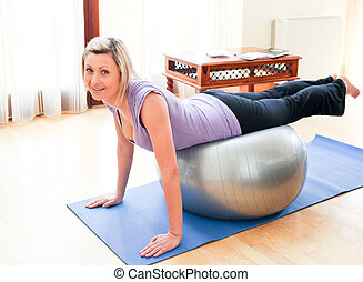 Athletic woman doing exercice at home