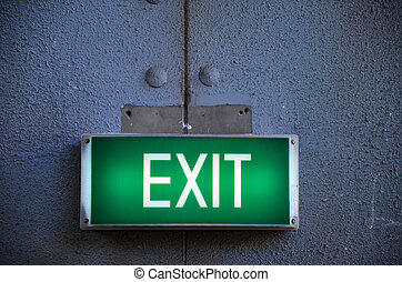 Exit sign points the way out of building