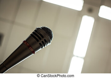 Black microphone in conference room Filtered image processed...