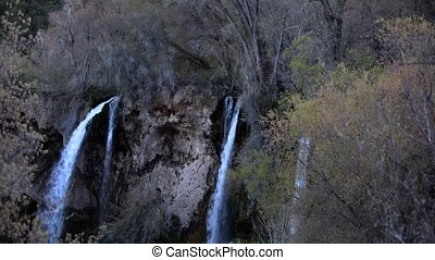 Rifle Falls Colorado pan down to foot bridge - Cascading...
