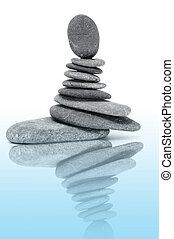 zen stones - a pile of zen stones on a white background