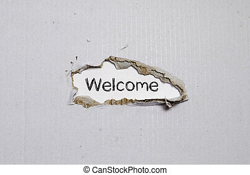 The word welcome appearing behind torn paper.