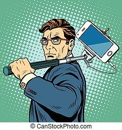 Selfie man blogger smartphone pop art retro vector....