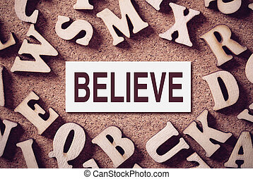 Believe Concept Word - Corkboard covered with word Believe...