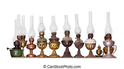 Several old kerosene lamp on a light background - Several...