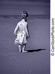 Blue toned image of a tiny girl and her shadow