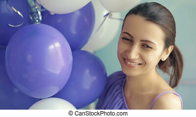 Smiling woman with balloons - Smiling woman holding baloons...