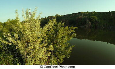 Flooded quarry on nature - Panorama Quarry filled with water...