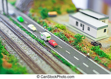 City in miniature. Roadway near railroad.
