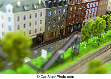 City in miniature. Street near railroad tracks.