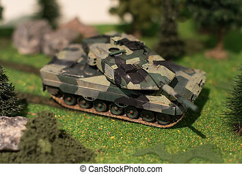 World in miniature. Military tank model.