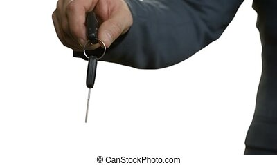 Businessmen pass car key Mens handshake on white background...