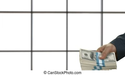 Men's hand passes money. Monetary deal on white background....