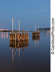 Two wooden boat jetty's in water
