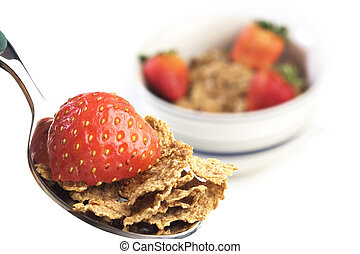 Bowl of breakfast cereal with straw