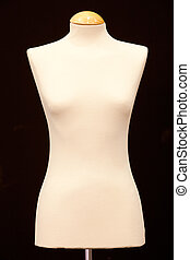 Bare-breasted mannequin isolated on black background