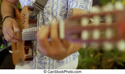 Closeup of musician playing the guitar. Shallow dept of...