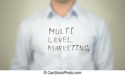 quot;MLM, Multi Level Marketing, Man writing on transparent...