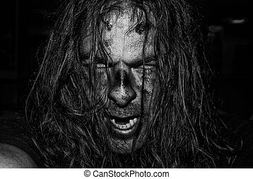Scary Evil Zombie - The face of an evil, male zombie in...