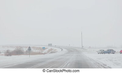 Snowstorm on highway - Danger and fast speed driving at the...
