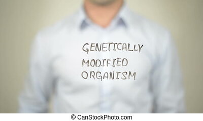 """gmo genetically modified organism , Man writing on..."