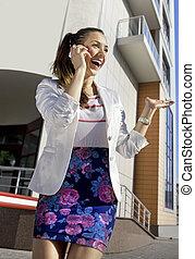 happy woman speaks on phone