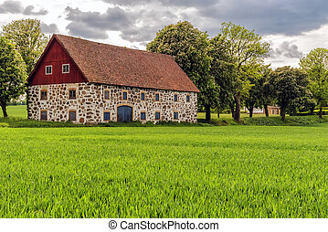 Stone barn in Sweden - An old stone barn with wooden roof...