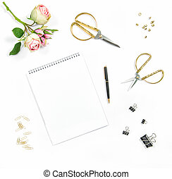 Flat lay with sketchbook, flowers, office tools on white...