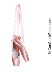 Hung ballet shoes - Hanging pink ballet shoes isolated on a...