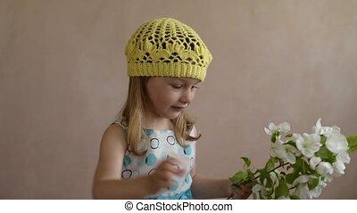 Little girl throwing a flower
