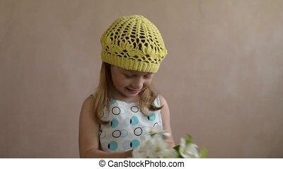 Little girl throwing an apple flower