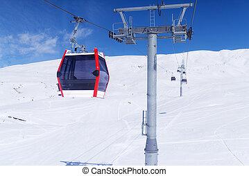 The gondola lift to the ski resort - Gondola lift in the ski...