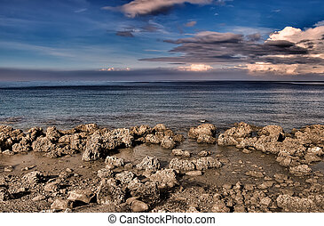 Natural rocky coastline with beautiful blue sky