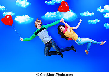 flight of fancy - Couple of young people in love flying in...