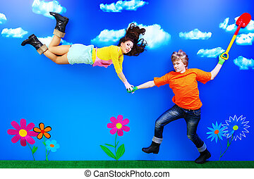 juvenility - Couple of young people in love flying in the...