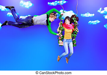 youth time - Couple of young people in love flying in the...