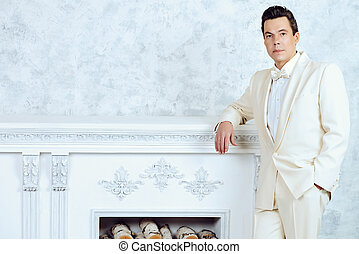 mature man in white suit - Handsome well-dressed mature man...