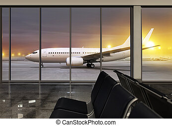 window in airport at night - passenger plane expects...