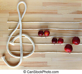Treble clef and stave made with white ropes on the deck with...