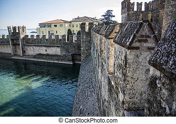 Old walls around Sirmione, italian town on Lake Garda....