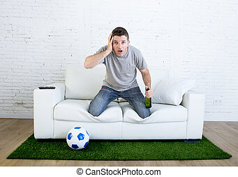 stressed football fanatic fan watching game on tv nervous in...