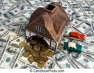 Invest in real estate and win concept - House and cars...
