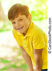 Cheerful male child is enjoying the nature - Portrait of...