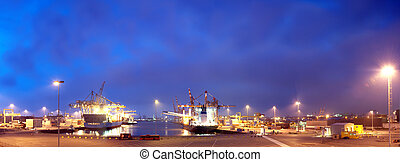 Rotterdam Harbor at night, with a view of the docks and the...