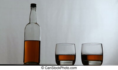 Glasses of whiskey with bottle - Two glasses of whiskey with...