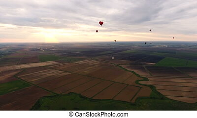 Hot air balloons in the sky over a field.Aerial view - Hot...