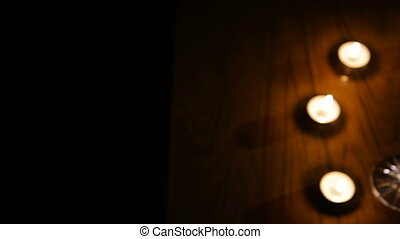 Wine glasses and burning candles - Two glasses of wine on...
