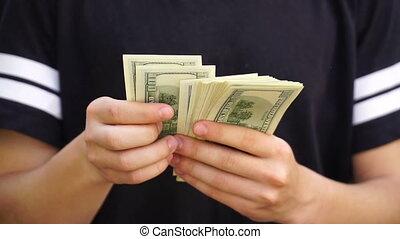 footage teenager showing off their money.